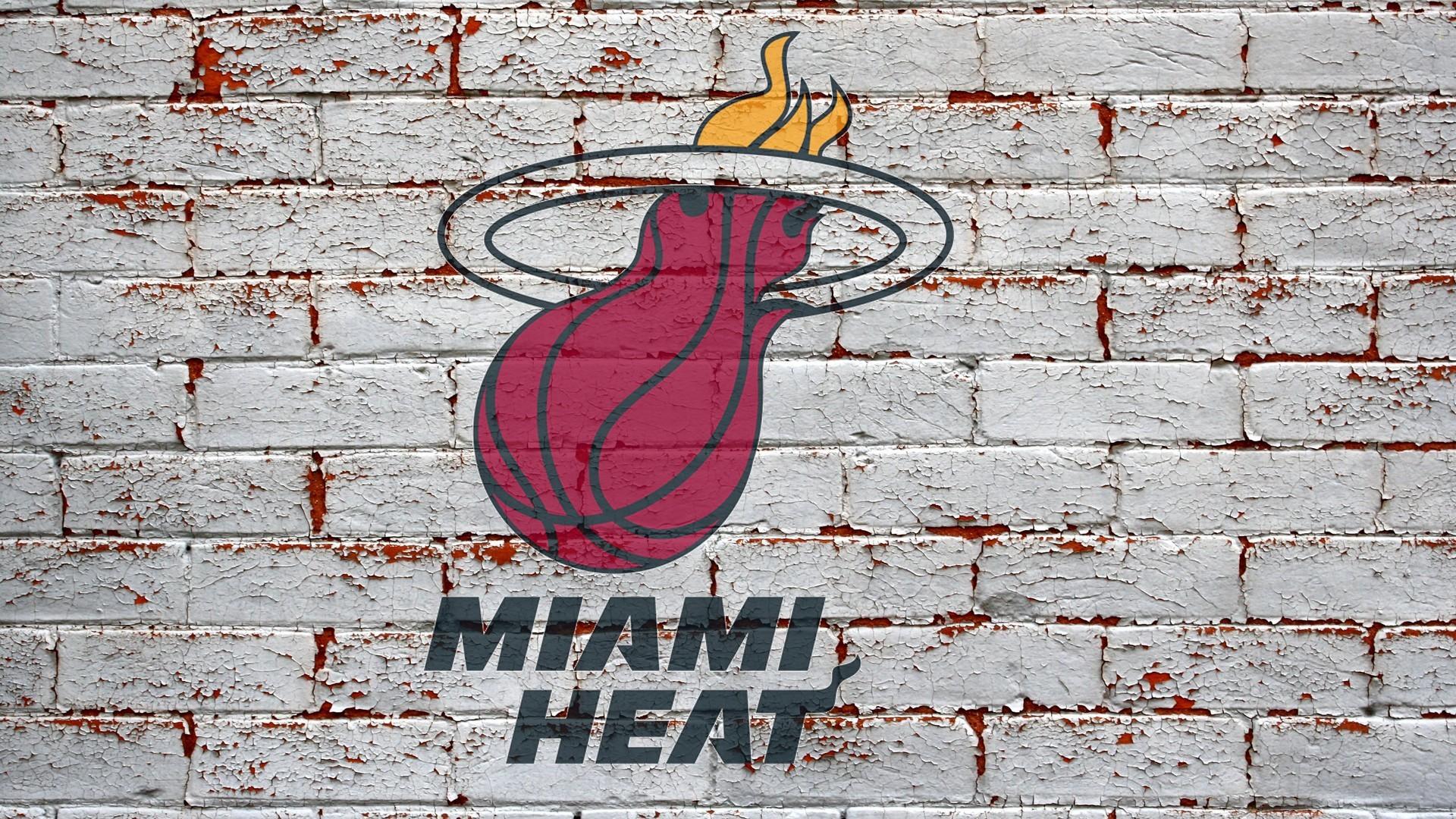 miami heat logo on grey brick wall