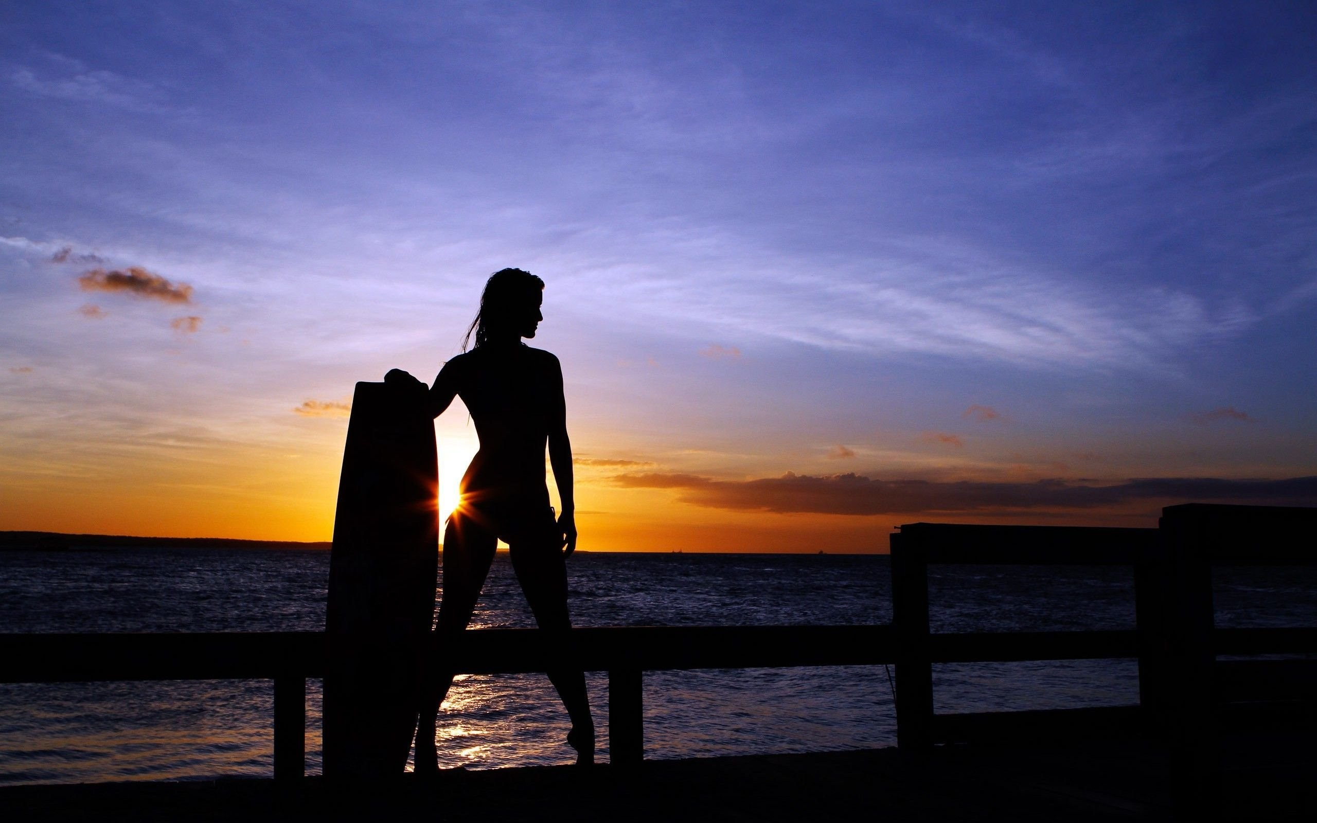 Woman Surfer In The Sunset