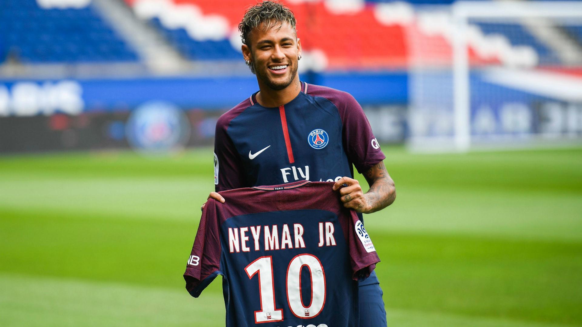 Neymar holding his PSG number 10 shirt