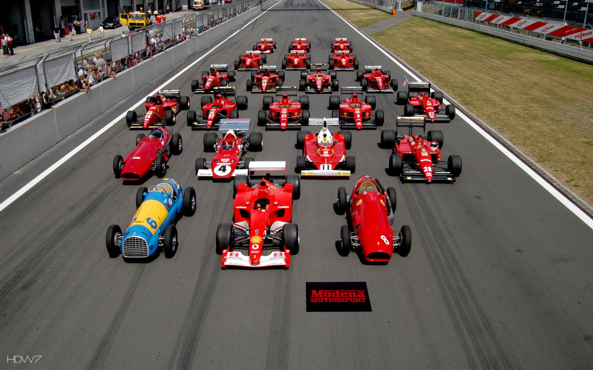 ferrari formula 1 history cars on a circuit wallpaper