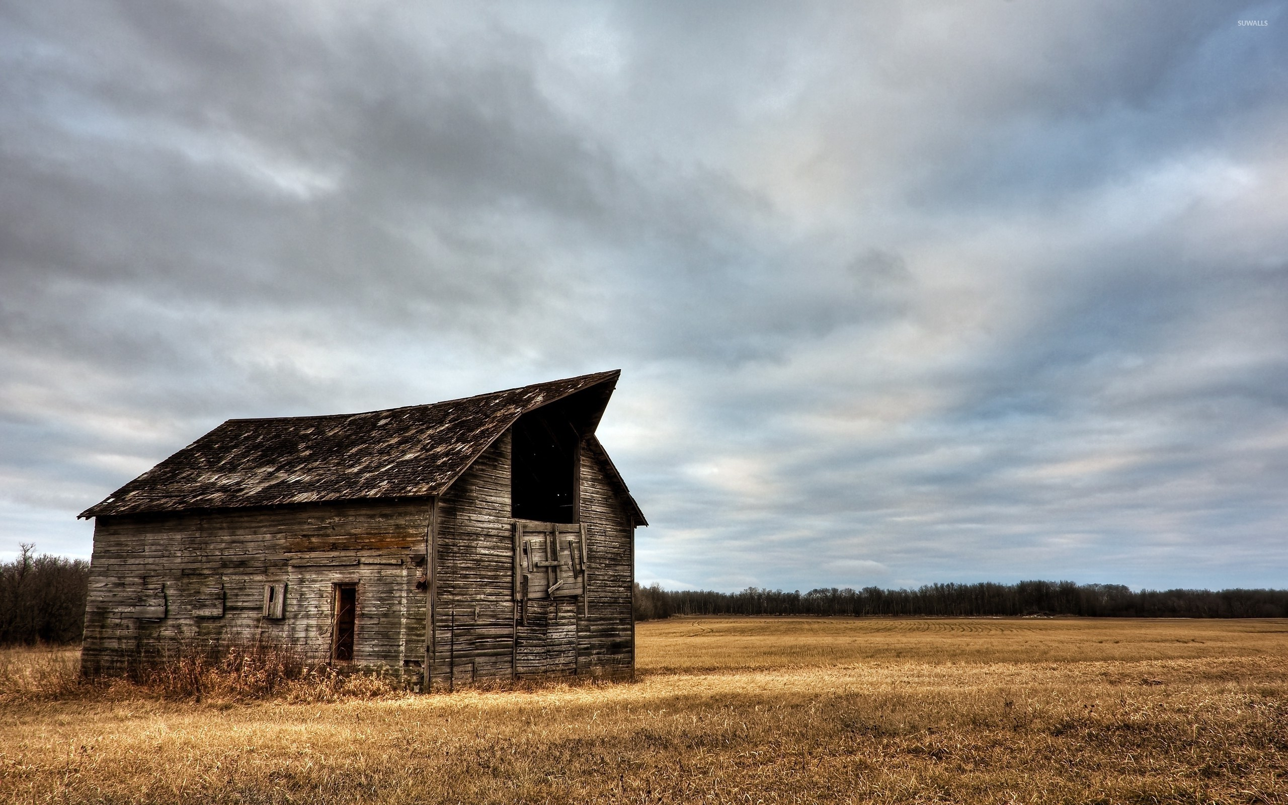 Abandoned wooden barn on a clouded day wallpaper jpg