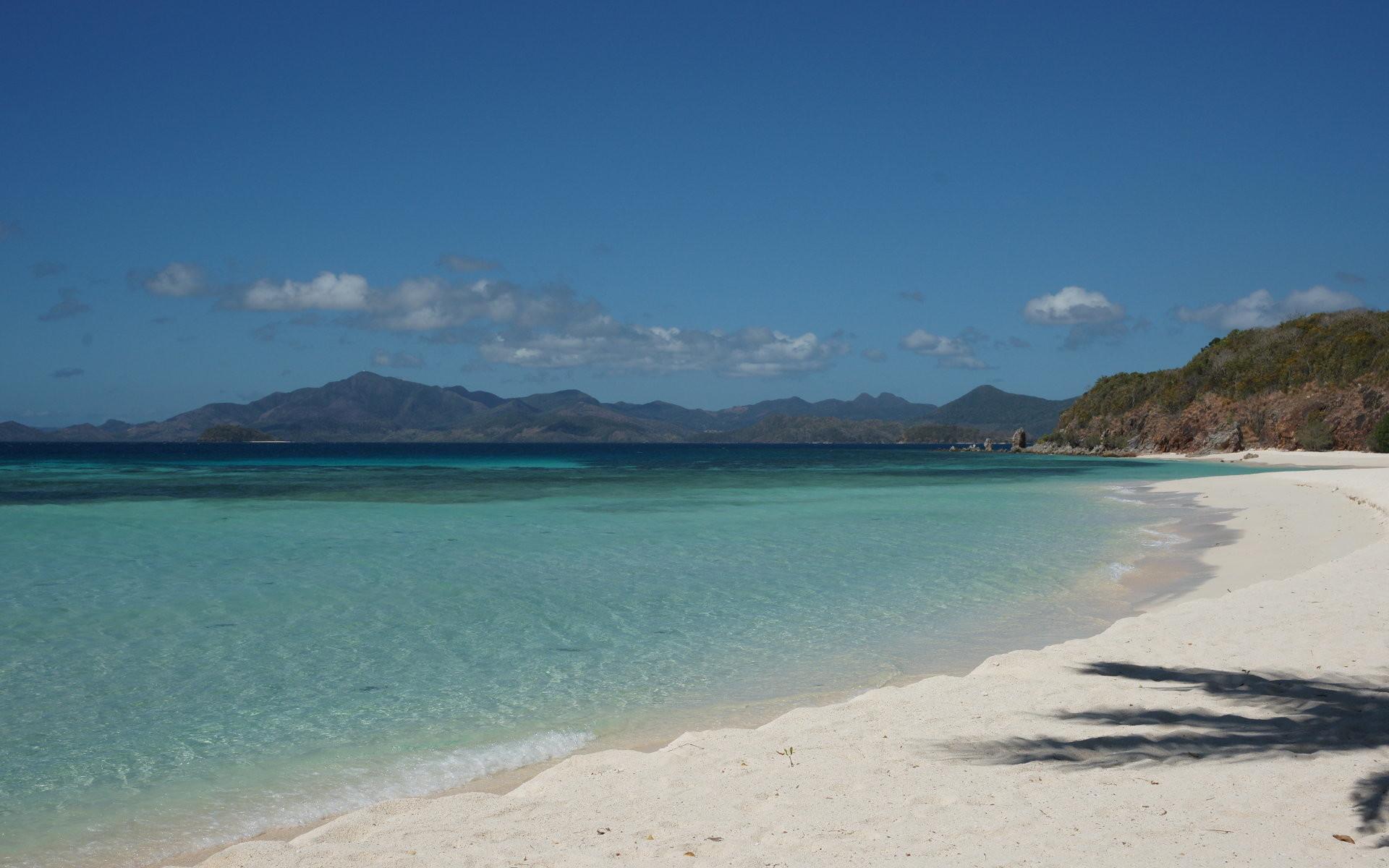 high resolution wallpaper 1920x1200px. Malcapuya island most beautiful beach
